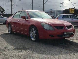 2003 Mitsubishi Verada KL GTVi Red 5 Speed Sports Automatic Sedan.