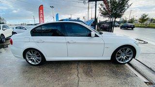2010 BMW 3 Series E90 MY10.5 320i Steptronic Lifestyle White 6 Speed Sports Automatic Sedan.
