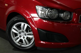 2012 Holden Barina TM MY13 CD Red 6 Speed Automatic Hatchback.