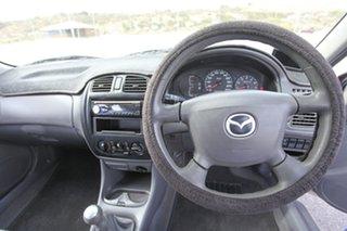 2001 Mazda 323 BJ II Protege Gold 5 Speed Manual Sedan.