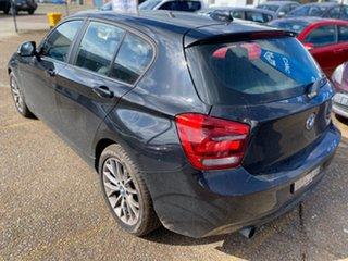 2014 BMW 1 Series F20 MY0713 118i Steptronic Black Sapphire 8 Speed Sports Automatic Hatchback.