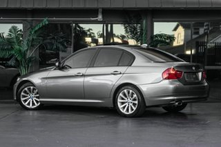 2009 BMW 3 Series E90 MY09 320i Steptronic Executive Grey 6 Speed Sports Automatic Sedan.