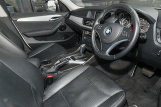 2010 BMW X1 E84 MY11 sDrive18i Steptronic Alpine White 6 Speed Sports Automatic Wagon.