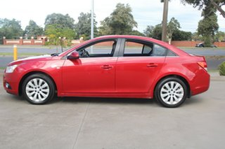2011 Holden Cruze JH CDX Red 6 Speed Automatic Sedan.