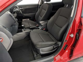 2012 Hyundai i30 FD MY11 SLX Red 4 Speed Automatic Hatchback.