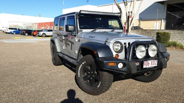 Used Jeep Wrangler Unlimited JK MY09 Sport (4x4) Underwood, 2010 Jeep Wrangler Unlimited JK MY09 Sport (4x4) Silver 4 Speed Automatic Softtop