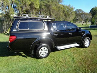 2013 Mitsubishi Triton MN MY13 GLX Double Cab Black 4 Speed Sports Automatic Utility
