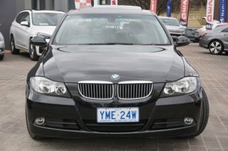 2006 BMW 3 Series E90 325i Steptronic Black 6 Speed Sports Automatic Sedan.