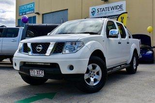 2006 Nissan Navara D40 ST-X (4x4) White 6 Speed Manual Dual Cab Pick-up.