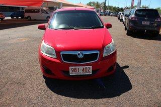 2010 Holden Barina TK MY10 Red Mica 5 Speed Manual Hatchback.