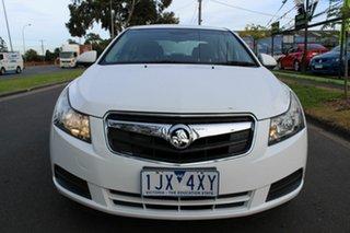 2010 Holden Cruze JG CD White 6 Speed Sports Automatic Sedan.