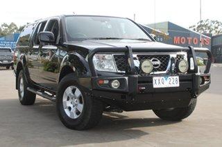 2010 Nissan Navara D40 ST (4x4) Black 5 Speed Automatic Dual Cab Pick-up.