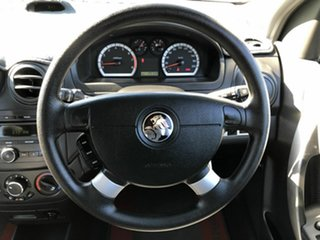 2010 Holden Barina TK MY11 White 5 Speed Manual Sedan