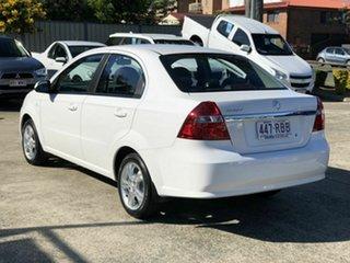 2010 Holden Barina TK MY11 White 5 Speed Manual Sedan.