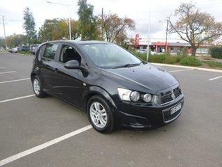 2012 Holden Barina TK Black Manual Hatchback.