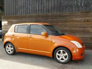 2005 Suzuki Swift RS415 Z Series Orange 5 Speed Manual Hatchback.