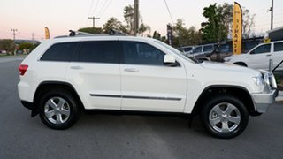 2011 Jeep Grand Cherokee WK MY2011 Overland White 5 Speed Sports Automatic Wagon.