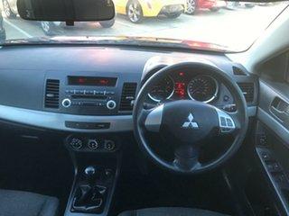 2011 Mitsubishi Lancer CJ MY11 ES Red 5 Speed Manual Sedan.
