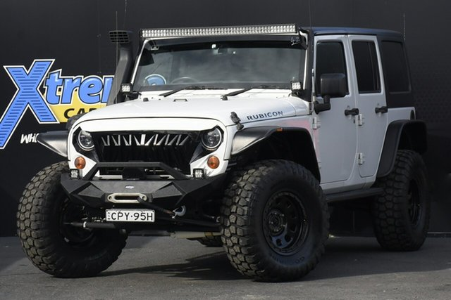 Used Jeep Wrangler JK MY2013 Unlimited Rubicon 10th Anniversary Campbelltown, 2013 Jeep Wrangler JK MY2013 Unlimited Rubicon 10th Anniversary White 5 Speed Automatic Softtop