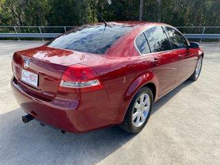 2006 Holden Berlina VE Red 4 Speed Automatic Sedan.