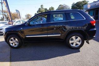 2013 Jeep Grand Cherokee WK MY2013 Laredo Brilliant Black 5 Speed Sports Automatic Wagon.