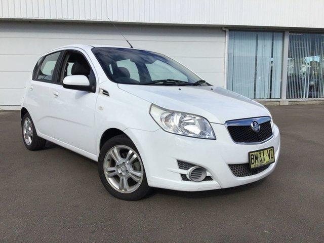 Used Holden Barina TK MY11 Cardiff, 2011 Holden Barina TK MY11 White 5 Speed Manual Hatchback