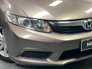 2012 Honda Civic 9th Gen VTi-L Urban Titanium 5 Speed Sports Automatic Sedan.