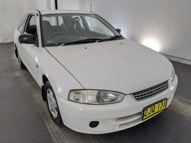 Used Mitsubishi Mirage CE MY2002 Maryville, 2003 Mitsubishi Mirage CE MY2002 White 5 Speed Manual Hatchback