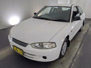 2003 Mitsubishi Mirage CE MY2002 White 5 Speed Manual Hatchback.