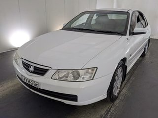 2003 Holden Berlina VY White 4 Speed Automatic Sedan.