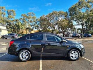 2012 Holden Barina TM MY13 CD Black 6 Speed Automatic Sedan.