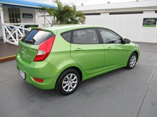 2014 Hyundai Accent Green 5 Speed Manual Hatchback.