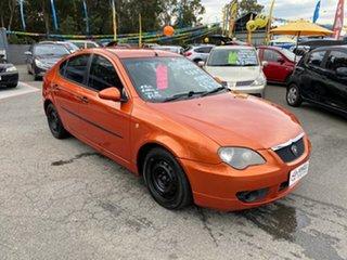 2010 Proton Gen 2 CM MY09 G Orange 5 Speed Manual Hatchback.
