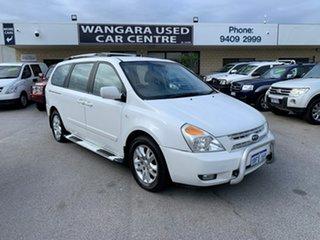 2009 Kia Grand Carnival VQ Premium White 5 Speed Tiptronic Wagon.
