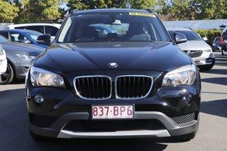 2013 BMW X1 E84 LCI sDrive20i Steptronic Black 8 Speed Sports Automatic Wagon.