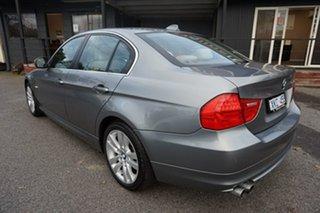 2009 BMW 3 Series E90 MY10 325i Steptronic Space Grey 6 Speed Sports Automatic Sedan.