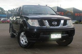 2010 Nissan Navara D40 ST (4x4) Black & Chrome 6 Speed Manual Dual Cab Pick-up.