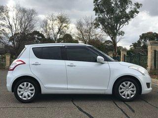 2012 Suzuki Swift FZ GL White 4 Speed Automatic Hatchback.
