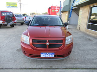2006 Dodge Caliber PM SX Orange 6 Speed Automatic Wagon.