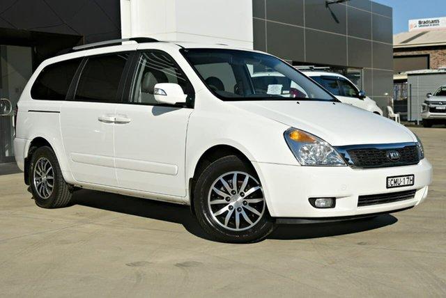 Used Kia Grand Carnival VQ MY13 Platinum Tuggerah, 2013 Kia Grand Carnival VQ MY13 Platinum White 6 Speed Sports Automatic Wagon