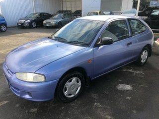 1998 Mitsubishi Mirage CE Blue 5 Speed Manual Hatchback.