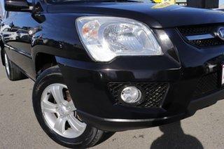 2009 Kia Sportage KM2 MY10 LX Ebony Black 4 Speed Automatic Wagon.