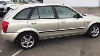 2003 Mazda 323 BJ II-J48 Astina Gold 5 Speed Manual Hatchback.