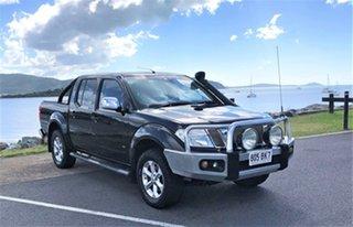 2012 Nissan Navara D40 S6 MY12 ST-X 550 Black Automatic.