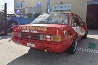 1986 Holden Commodore VL SL Red 5 Speed Manual Sedan.