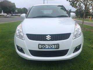 2011 Suzuki Swift FZ GLX White 5 Speed Manual Hatchback.