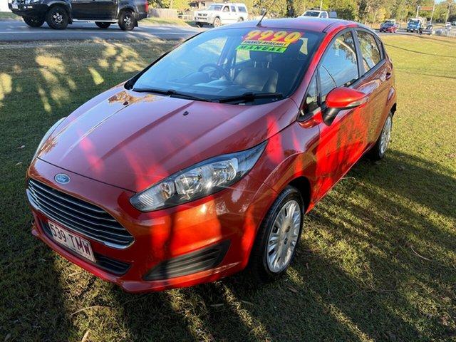 Used Ford Fiesta WZ Ambiente Clontarf, 2013 Ford Fiesta WZ Ambiente Orange 5 Speed Manual Hatchback