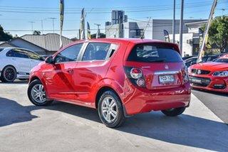 2014 Holden Barina TM MY15 CD Blaze Red 6 Speed Automatic Hatchback.