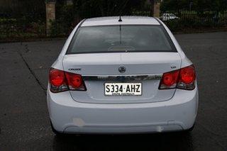 2010 Holden Cruze JG CD White 6 Speed Automatic Sedan.