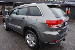 2011 Jeep Grand Cherokee WK MY2011 Laredo Mineral Grey 5 Speed Sports Automatic Wagon.